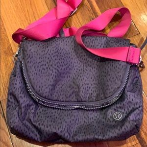Lulu lemon crossbody bag with a pink strap